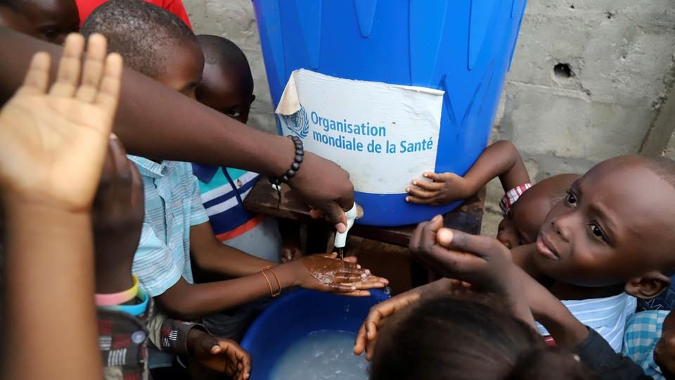 Congolese children wash their hands as a preventive measure against Ebola at the Church of Christ in Mbandaka, Democratic Republic of Congo on May 20, 2018.
