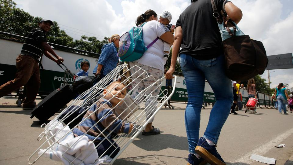 In this February 23, 2018 photo, Venezuelan citizens arrive to La Parada neighbourhood of Cucuta, Colombia, on the border with Venezuela. Aside from providing health care, border cities are also coping with an array of public safety issues, like a rise in prostitution and groups of men, women and children sleeping on the streets.