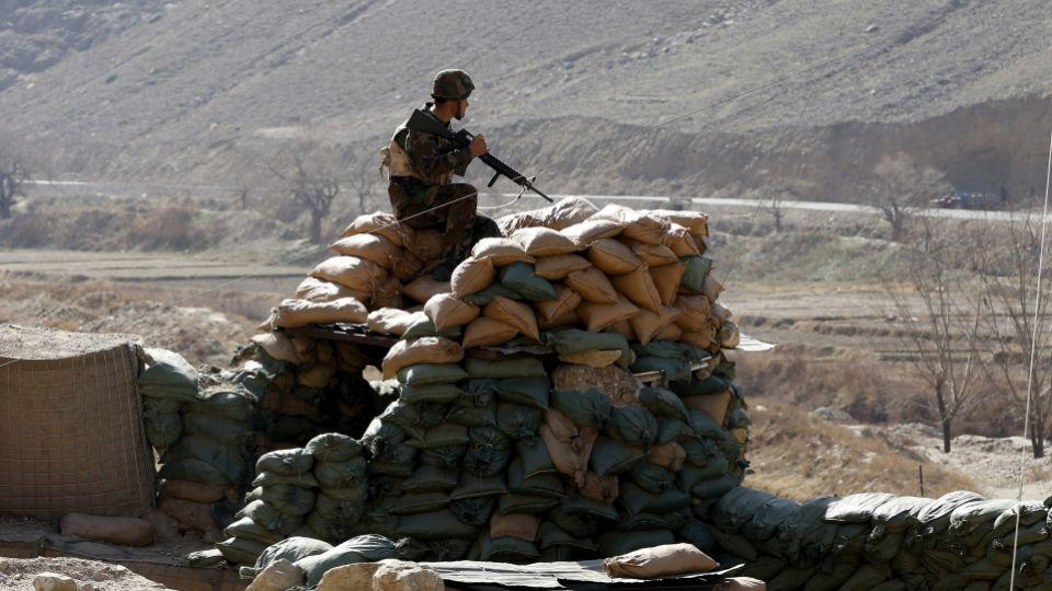 An Afghan National Army (ANA) soldier keeps watch at a checkpost in Logar province, Afghanistan February 16, 2016