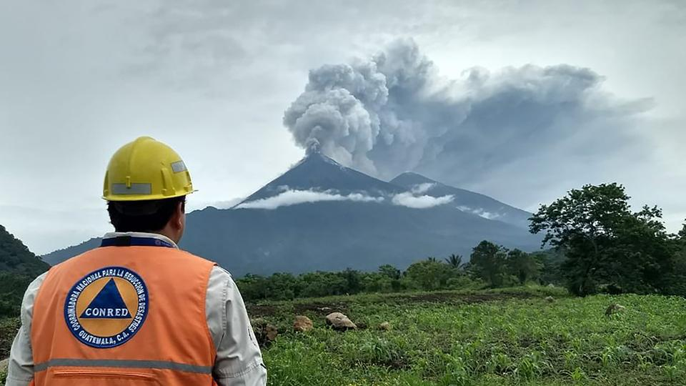 This Handout picture released by the National Disaster Relief Agency of Guatemala shows Volcano Fuego during an eruptive pulse in El Rodeo, Guatemala on June 3, 2018.