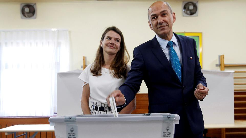 Janez Jansa, leader of the Slovenian Democratic Party (SDS), and his wife Urska cast their votes at a polling station during the general election in Velenje, Slovenia, on June 3, 2018.