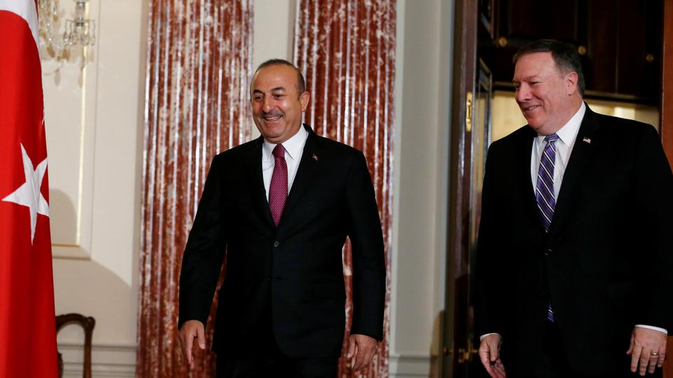 Turkish Foreign Minister Mevlut Cavusoglu (L) and US Secretary of State Mike Pompeo at the State Department in Washington, US, on June 4, 2018.