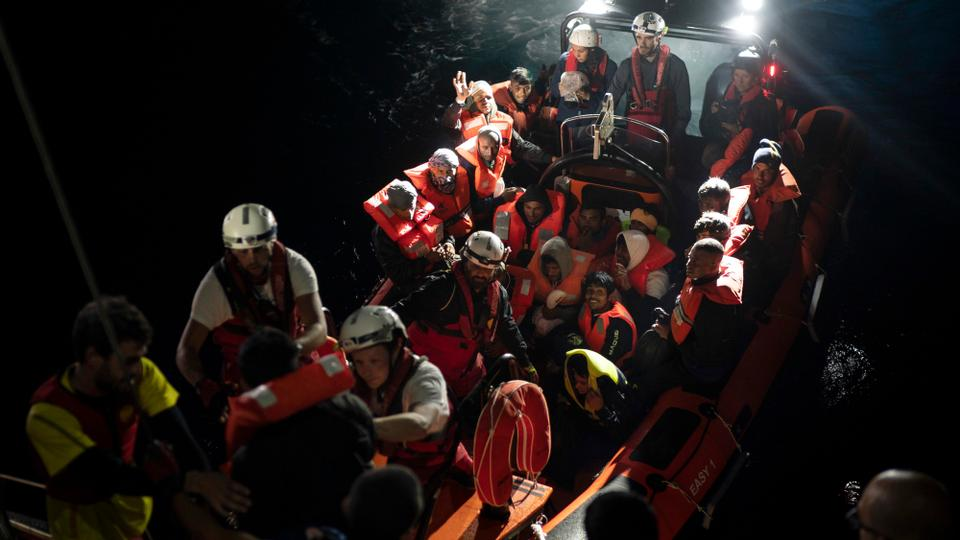 Refugees and migrants are transferred to the SOS Mediterranee Aquarius rescue ship a day after being rescued by members of the Spanish NGO Proactiva Open Arms, after they tried to leave Libya and reach European soil aboard an overcrowded rubber boat, Monday, May 7, 2018.