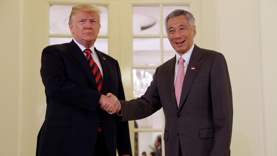 President Donald Trump shakes hands as he meets Singapore Prime Minister Lee Hsien Loong ahead of a summit with North Korean leader Kim Jong-un, Monday, June 11, 2018, in Singapore.