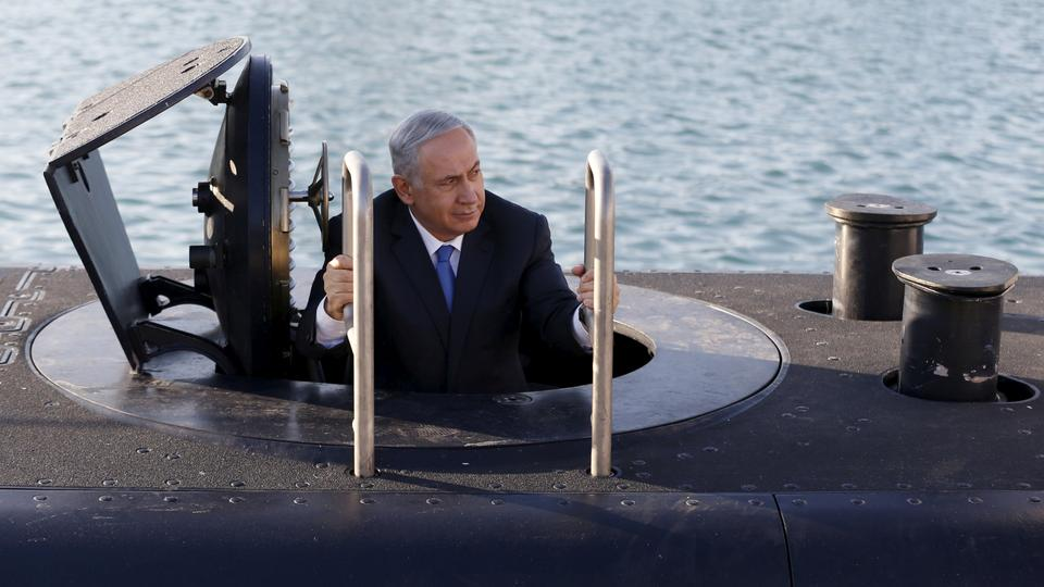 Israeli Prime Minister Benjamin Netanyahu climbs out after a visit inside the Rahav, the fifth submarine in the Israeli Navy's fleet, after it arrived in Haifa port. January 12, 2016.