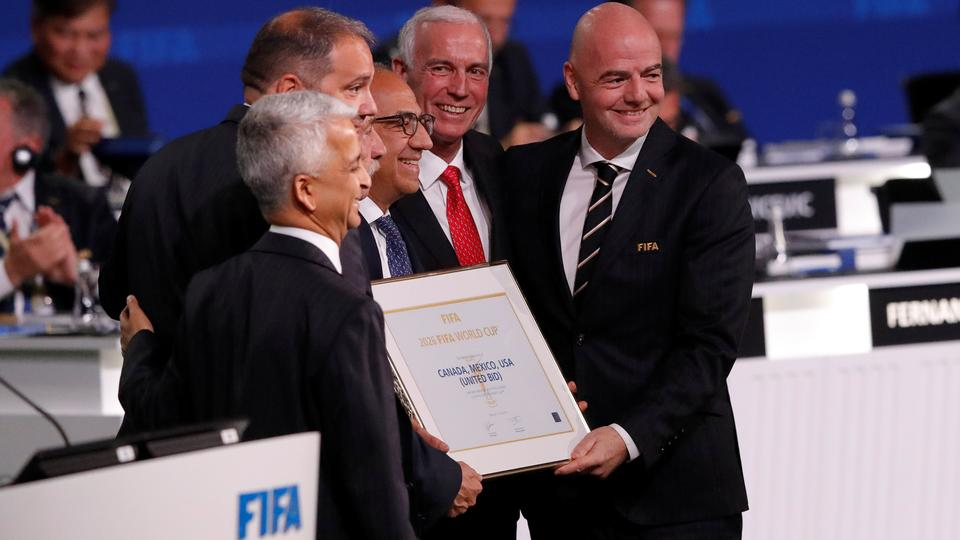 FIFA President Gianni Infantino (R) poses for a picture with officials after the announcement, that the 2026 FIFA World Cup will be held in the United States, Mexico and Canada, during the 68th FIFA Congress in Moscow, Russia on June 13, 2018.