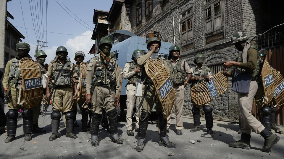 Indian troops stand guard during a clashes with Kashmiri protestors after Friday prayers during the last Friday of Holy month of Ramadan in downtown Srinagar on June 8, 2018.