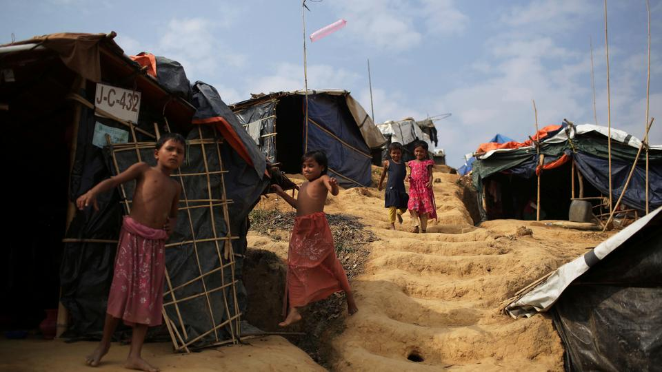 Rohingya children walk to and from tents in Jamtoli refugee camp on Friday, November 24, 2017, in Bangladesh.