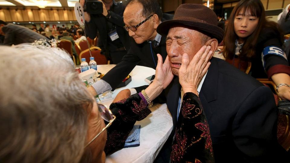 South Korean Kim Bok-rak, right, reacts as he meets his North Korean sister Kim Jeon-soon during the separated family reunions at Mount Kumgang resort, North Korea on October 20, 2015.