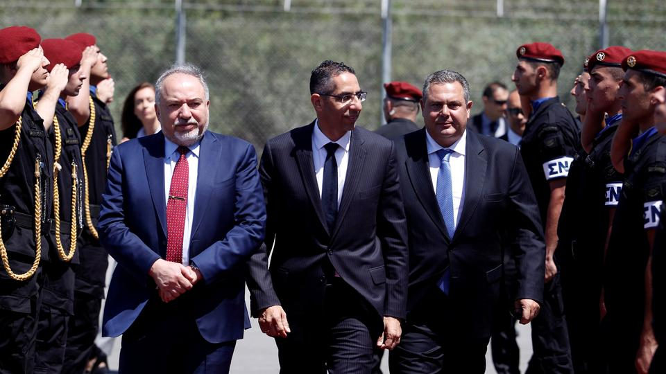 Greek Cypriot Defence Minister Savvas Angelides (C), Israeli Defence Minister Avigdor Lieberman (L) and Greek Defence Minister Panos Kammenos walk before a trilateral meeting in Larnaca, Cyprus on June 22, 2018.