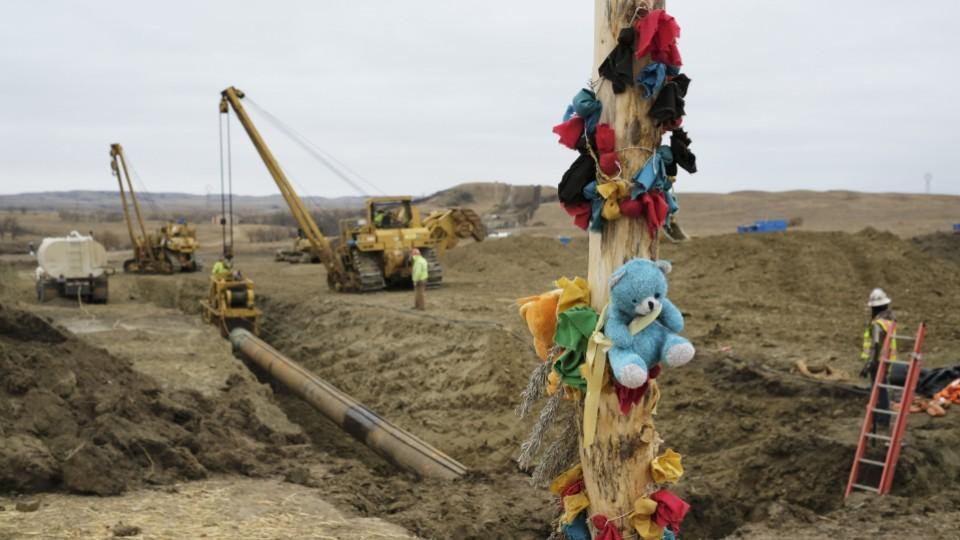 Protesters against the construction left a log adorned with colorful decorations at a Dakota Access Pipeline protest encampment as construction work continues on the pipeline near the town of Cannon Ball, North Dakota, US, October 30, 2016.