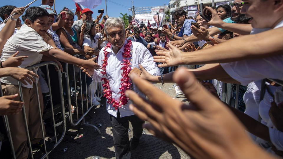 Mexico's presidential candidate for the MORENA party, Andres Manuel Lopez Obrador, greets supporters during a campaign rally in Acapulco, Guerrero State, Mexico, on June 25, 2018 ahead of the July 1 presidential election.