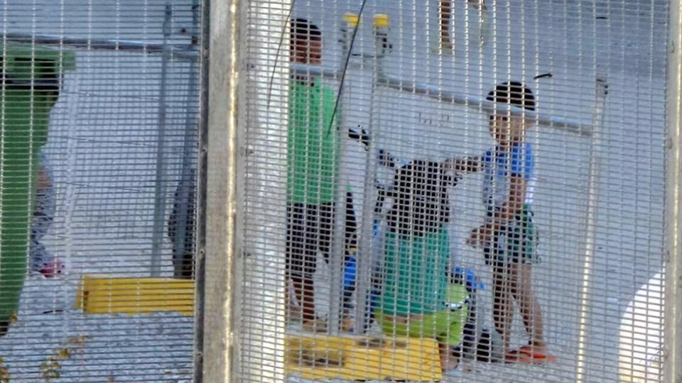 Australia's asylum policy has been repeatedly condemned by rights groups and the UN. File Photo: Children play near a fence at the Australian-run detention centre on the Pacific island nation of Nauru.