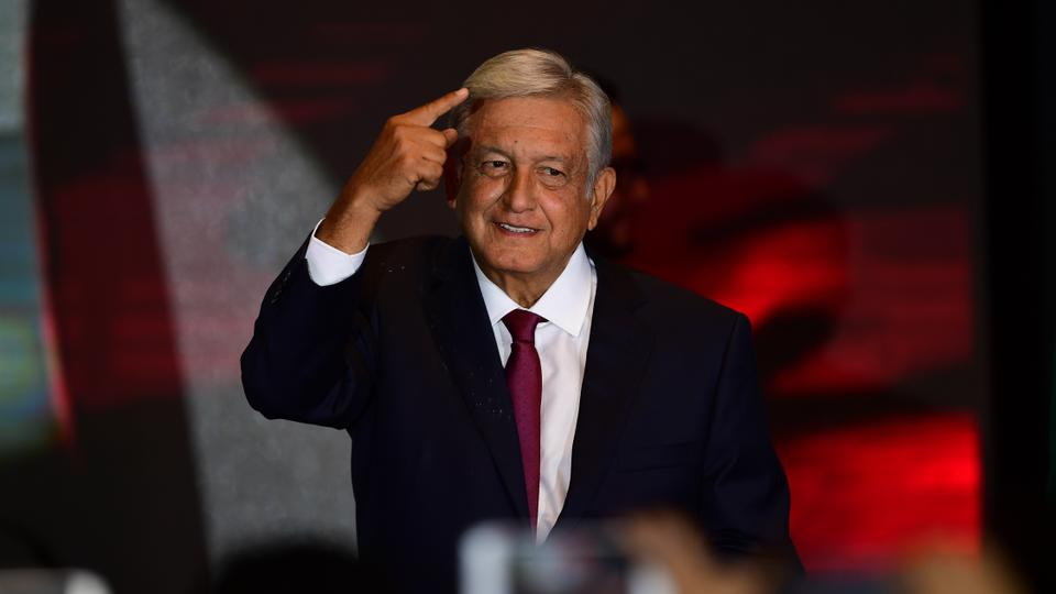 Newly elected Mexican President Andres Manuel Lopez Obrador, acknowledges his supporters after winning the presidential election, Mexico City, July 1, 2018.