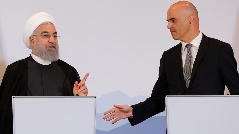 Swiss President Alain Berset and Iranian President Hassan Rouhani gesture after they deliver a statement after a two-day visit in Bern, Switzerland. July 3, 2018.