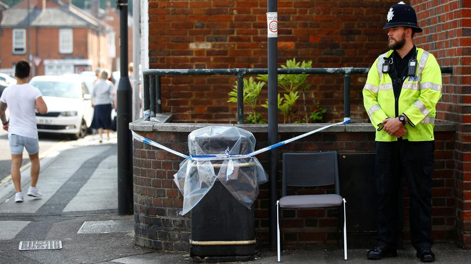 A police officer guards a cordoned-off rubbish bin on Rolleston Street, after it was confirmed that two people had been poisoned with a nerve agent Novichok, in Salisbury, Britain, July 5, 2018.