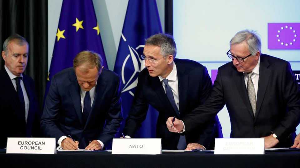European Council President Donald Tusk (L), NATO Secretary General Jens Stoltenberg (C) and European Commission President Jean-Claude Juncker (R) sign a new joint declaration on EU-NATO cooperation in Brussels, Belgium, July 10, 2018.