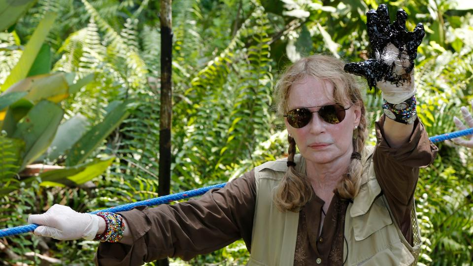 US actress Mia Farrow shows her gloved hand covered with oil during a visit to the Aguarico field in the Ecuadorean Amazonia region, Aguarico, Ecuador. Farrow was one of many celebrities to support Ecuador's campaign against the multinational oil company Chevron Corp, whose subsidiary Texaco is accused of massive pollution in Ecuador's Amazon rainforest between 1972 and 1990.