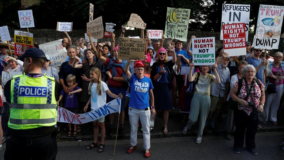 Demonstrators protest outside the grounds of Blenheim Palace, where US President Donald Trump and the First Lady Melania Trump are attending a dinner with Britain's Prime Minister Theresa May and business leaders, near Oxford.