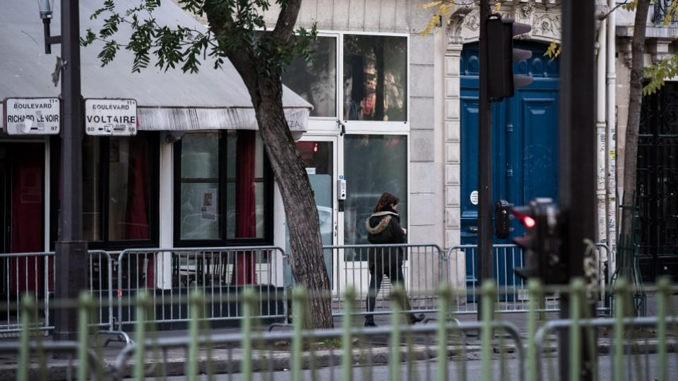 A woman walks near the Bataclan theatre at the Boulevard Voltaire in Paris on November 11, 2016, one year after the Paris terror attacks. Image: AFP.