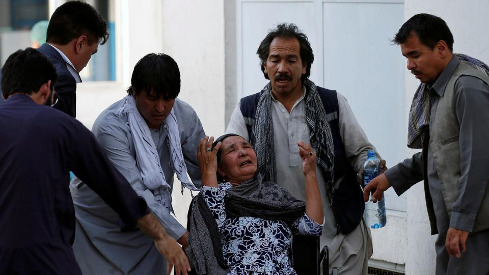 An Afghan woman mourns at the hospital after a blast in Kabul, Afghanistan July 15, 2018.