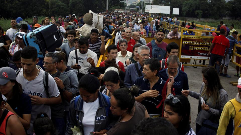 People cross the Colombian-Venezuelan border over the Simon Bolivar international bridge, Colombia June 27, 2018.