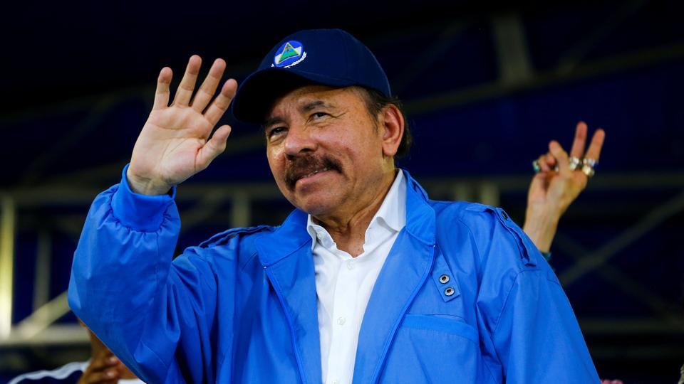 Nicaragua's President Daniel Ortega waves to supporters during celebrations to mark the 39th anniversary of the