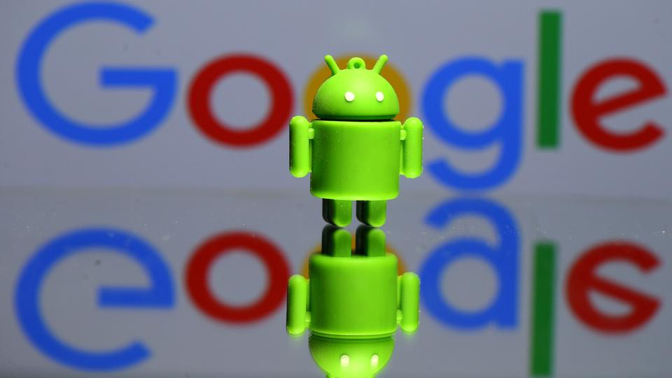 A 3D printed Android mascot Bugdroid is seen in front of a Google logo in this illustration, July 9, 2017.