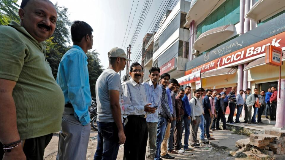 People queue to withdraw cash at an ATM in Lucknow, India. The move to take 500 and 1000 Rupee notes out of circulation has led to confusion and massive lines across the country.