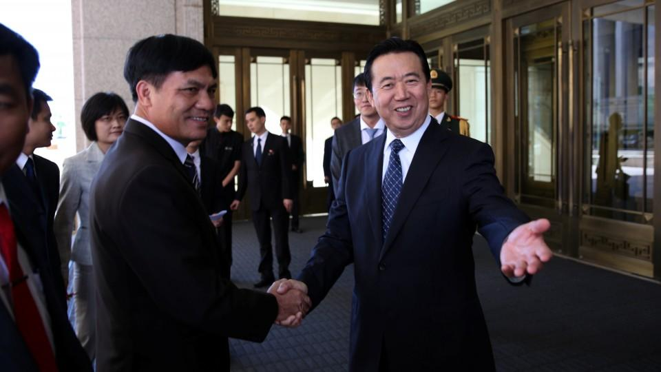 Rights organisations are critical of Interpol's decision to elect China's Vice Minister of Public Security Meng Hongwei (R).