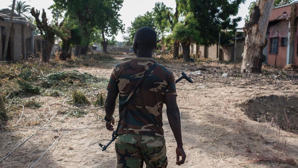A Nigerian soldier patrols in the streets of Bama in northeast Nigeria on  December 8,