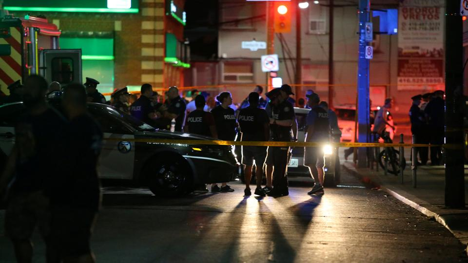 Police are seen near the scene of a mass shooting in Toronto, Canada, July 22, 2018.