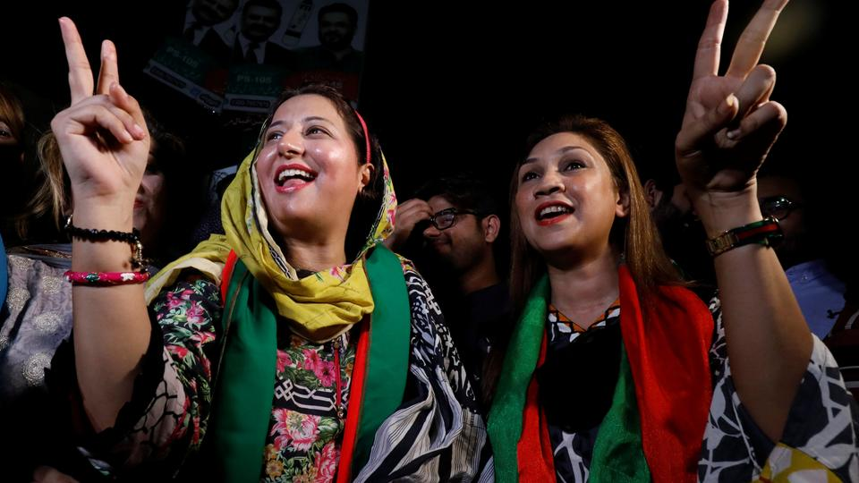 Supporters of cricket star-turned-politician Imran Khan, chairman of Pakistan Tehreek-e-Insaf (PTI), gesture to party songs with others, as they celebrate a day after the general electionsin Karachi, Pakistan July 26, 2018.