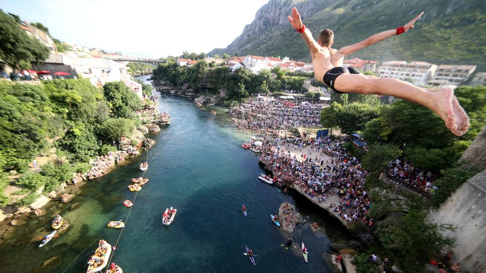 A man jumps from the Old Bridge during the 452nd traditional diving competition in Mostar, Bosnia and Herzegovina, July 29, 2018.