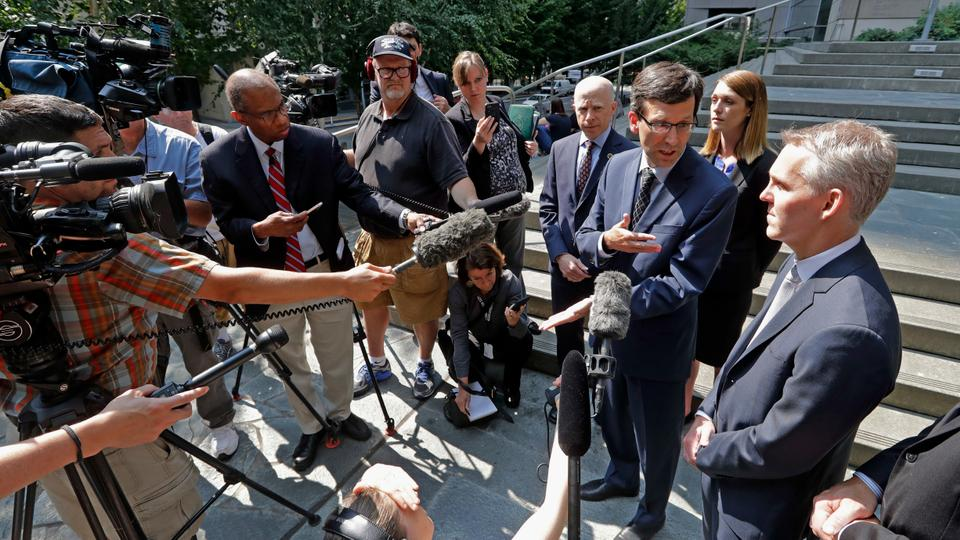 Washington Attorney General Bob Ferguson, third right, speaks with media members following a hearing where a federal judge issued a temporary restraining order to stop the release of blueprints to make untraceable and undetectable 3D-printed plastic guns on July 31, 2018 in Seattle.