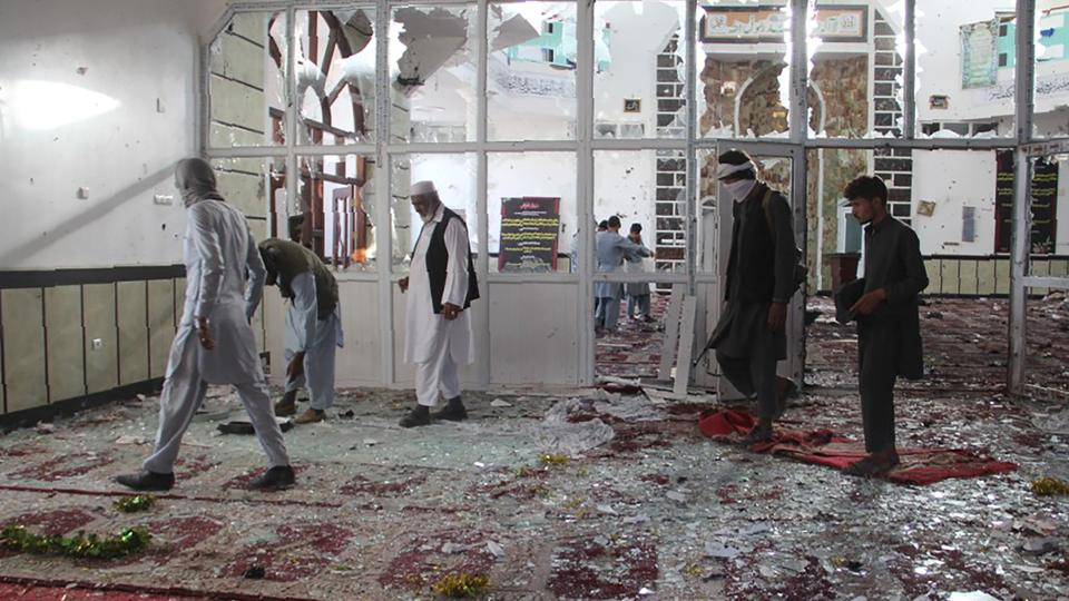 Burqa-clad suicide bombers struck a Shia mosque in eastern Afghanistan as it was crowded with worshippers for weekly prayers, officials say.
