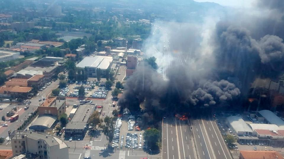 In this photo released by Italian firefighters, a helicopter view of the explosion on a highway in the outskirts of Bologna, Italy, August 6, 2018.