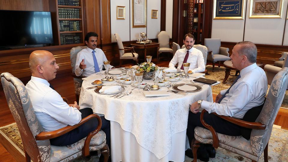 Qatar's Emir Sheikh Tamim bin Hamad al Thani, Turkish President Recep Tayyip Erdogan, Turkish Finance Minister Berat Albayrak and his Qatari counterpart Ali Sharif al Emadi holding lunchtime talks in Ankara, August 15, 2018.