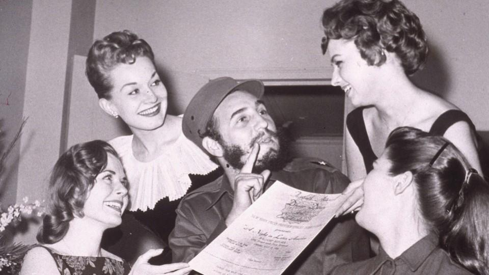 Cuban leader Fidel Castro is presented with an invitation to the New York Press Photographer's Ball, New York City, April 23, 1959.