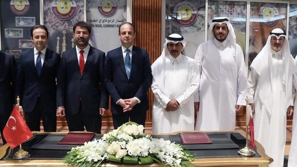 Governor of Central Bank of the Republic of Turkey (CBRT), Murat Cetinkaya (3rd L) and Governor of Qatar Central Bank Sheikh Abdulla Bin Saoud Al-Thani (3rd R) pose for a photo after signing the swap agreement in Doha, Qatar.