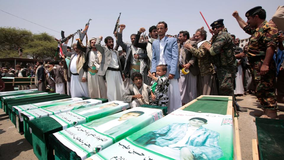 Yemeni people attend the funeral of victims of a Saudi-led air strike, in Saada, Yemen, Monday, Aug. 13, 2018.