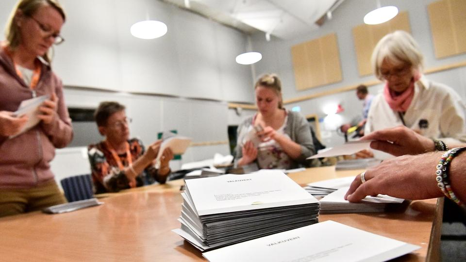 Electoral officials prepare to count ballots at a polling station in Malmo, Sweden September 9, 2018