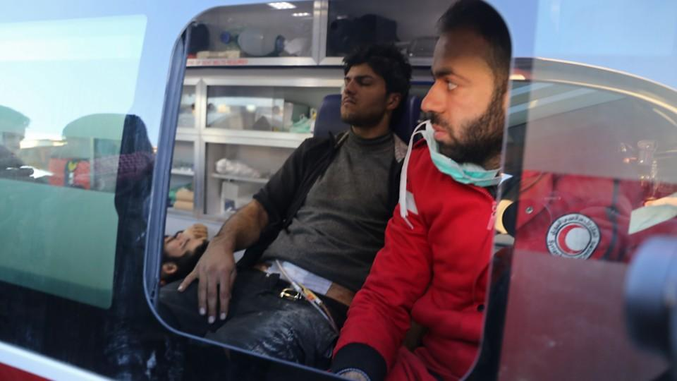 Wounded Syrians, who were evacuated from rebel-held neighbourhoods in the embattled city of Aleppo, sit in a Syrian Arab Red Crescent ambulance on their arrival in the opposition-controlled Khan al-Aassal region, west of the city on December 15, 2016.