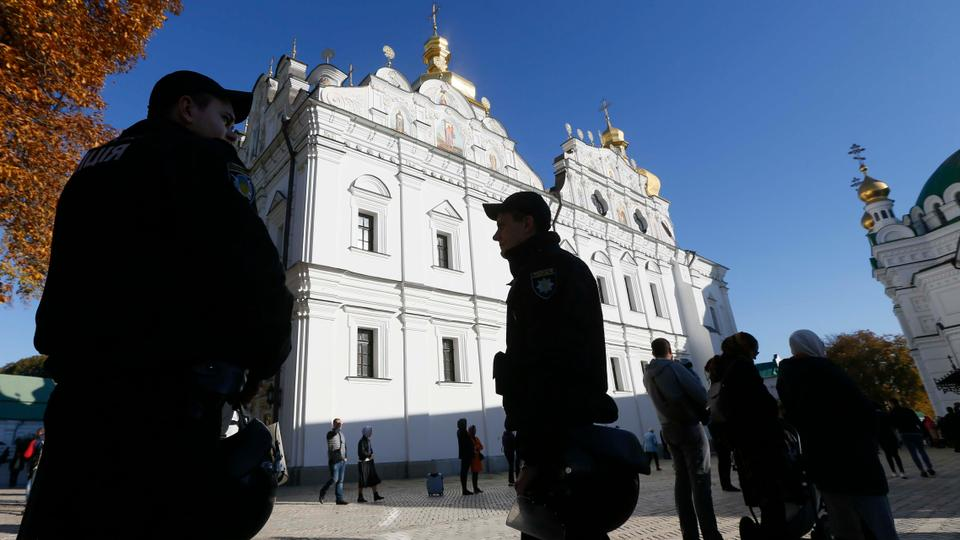 Policemen stand guard outside the Kiev Pechersk Lavra monastery in Kiev, Ukraine on October 14, 2018.