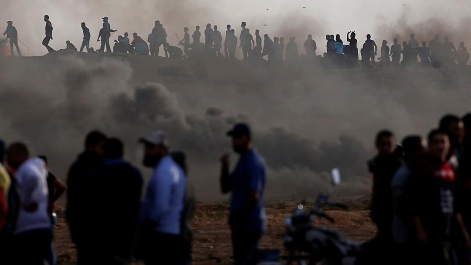 Palestinians gather at the Israel-Gaza border fence during a protest calling for lifting the blockade on Gaza, in Gaza, October 26, 2018.