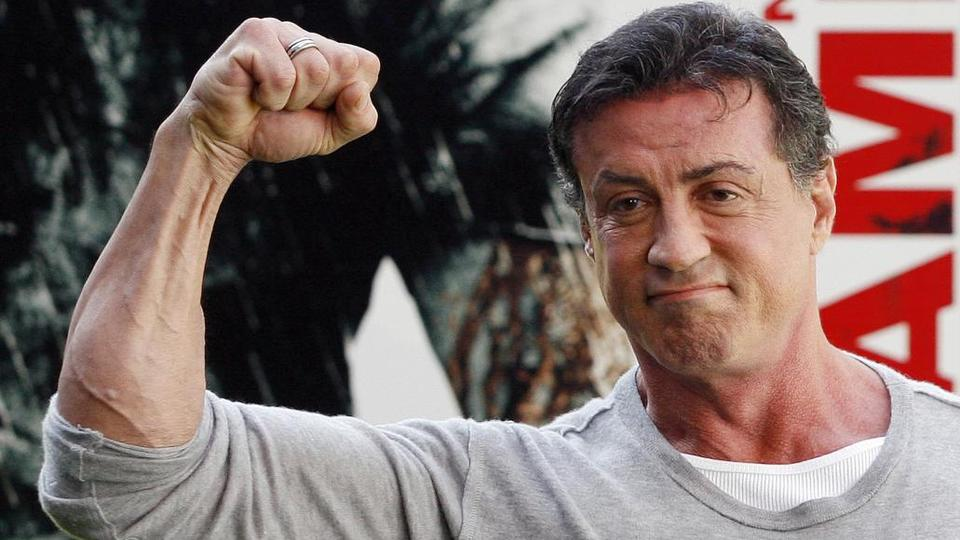Actor Sylvester Stallone poses during a photocall to promote the movie