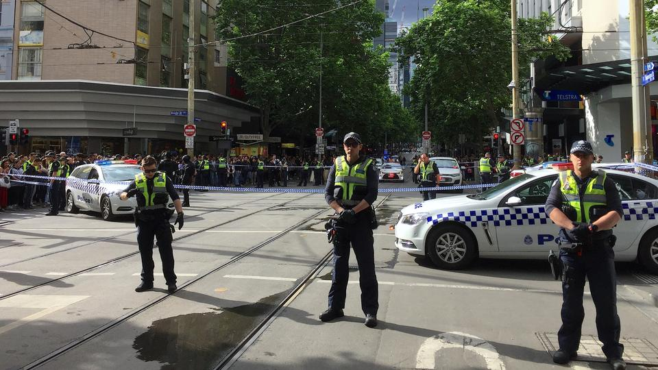 Policemen block members of the public from walking towards the Bourke Street mall in central Melbourne, Australia, November 9, 2018.