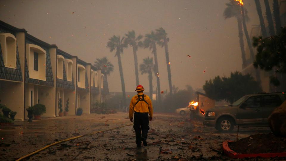 A firefighter walks through an apartment complex as the Woolsey Fire burns in Malibu, California, US on November 9, 2018. The fire destroyed dozens of structures, forced thousands of evacuations and closed a major freeway.