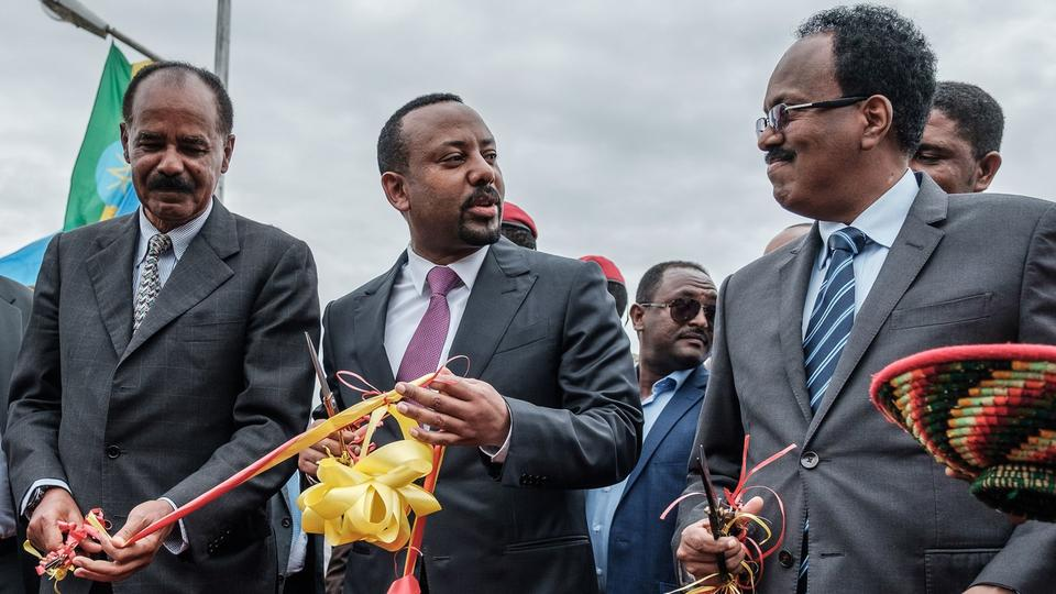 Eritrea's President Isaias Afwerki, Ethiopia's Prime Minister Abiy Ahmed, and Somalia's President Mohamed Abdullahi Mohamed (left to right) photographed after cutting the ribbon at a hospital inauguration in northern Ethiopia, on November 10, 2018. On Wednesday, the U.N. Security Counsel voted to lift sanctions on Eritrea as relations warm between the once-rival nations.