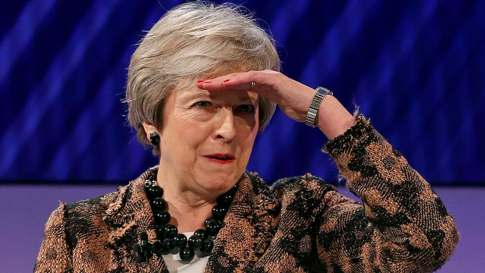 Britain's Prime Minister Theresa May gestures as she takes a question after speaking at the annual Confederation of British Industry conference in central London, on November 19, 2018.